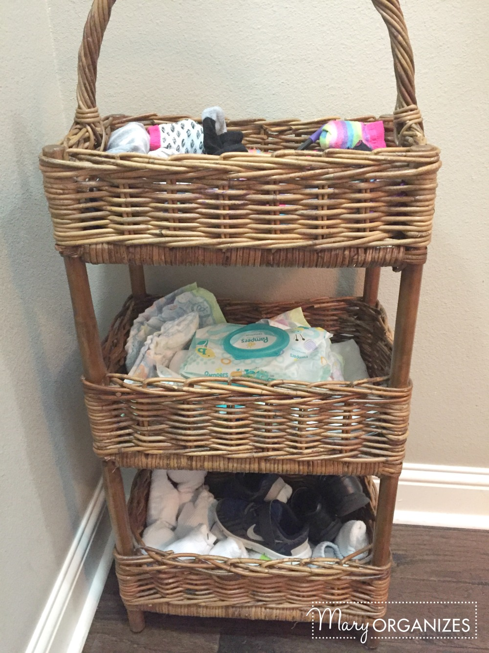 Mary organizes - mud area - organizers for socks toddler shoes and diapers